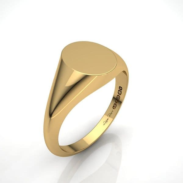 Ladies oval yellow gold signet ring