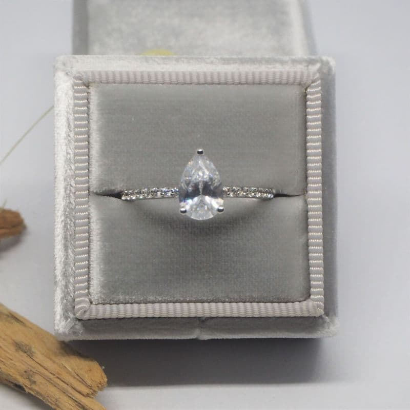 Pear diamond solitaire with diamond shoulders