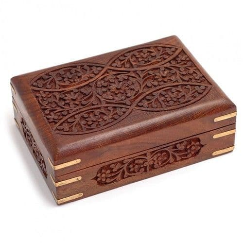 Carved wooden box with brass corners