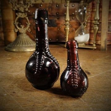 Two Ball and Claw Potion Bottles