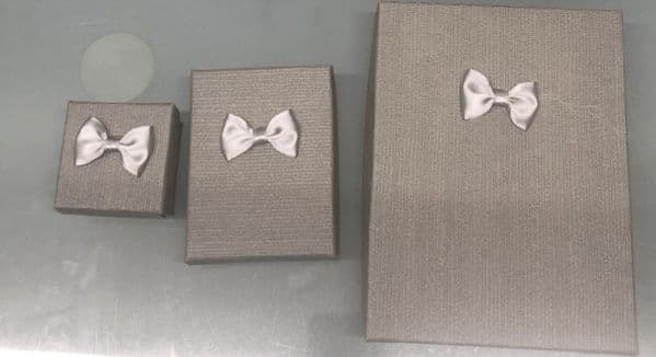 Grey 3 Textured jewellery boxes with bows