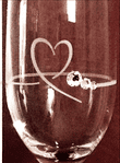 Close Up of Single diamante Petit Champagne Flute with Heart Shape cutting.