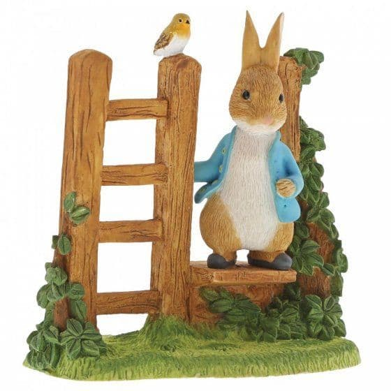 Peter Rabbit on a wooden stile figurine. A29835