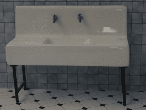 Porcelain dolls house kitchen sink.